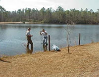 Collecting sediment samples from Crystal Lake, Lexington County, South Carolina.