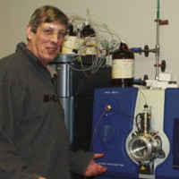Dr. Michael T. Meyer in front of laboratory analytical equipment