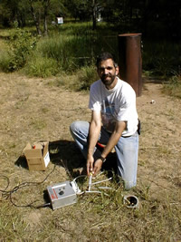 USGS scientist collecting an unsaturated-zone gas sample with a syringe from a vapor sampling well