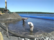 Scientists installing diffusion samplers in a subsurface reactive barrier, Ashumet Pond, Cape Cod MA