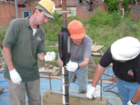 USGS scientists installing diffusion samplers and microcosms to study subsurface bacteria
