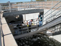 USGS scientists collecting a sample of wastewater effluent from the Ina Road wastewater treatment plant. The plant is located at mile 4.2 of the study reach on the Santa Cruz River, AZ, where the scientists studied the fate of 102 emerging contaminants over a 24-hour time period