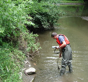 USGS scientist measuring dissolved oxygen in Fourmile Creek, Iowa.
