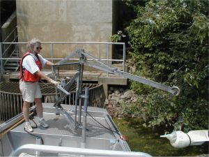 USGS scientist collecting water samples near an intake structures for a water-supply plant