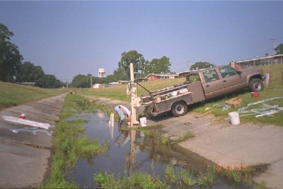 Pickup truck with direct-push system operating in a concrete lined stream