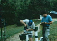 USGS scientists making a manual water-level measurement in a bedrock well.