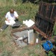USGS scientist collecting water-level data from an observation well during an aquifer test