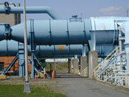 Large pipes and associated infrastructure used for jet engine testing.