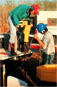 USGS scientists installing a drive point well
