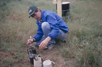 USGS scientist collecting gas samples from an unsaturated zone well.