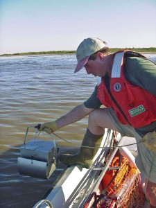USGS scientist collecting sediment from the bottom of the Salton Sea, CA