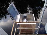 An autosampler set up to collect water samples from Black Creek near Blitchton, GA