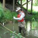 USGS scientist collecting a water-quality sample from Zollner Creek, Oregon