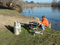 USGS scientist collecting a large-volume water samples from the San Joaquin River near Vernalis, CA