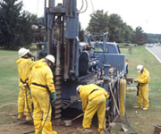 U.S. Environmental Protection Agency scientists operating a drill rig.