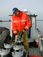 Scientists collecting large-volume water samples from the San Joaquin River, Calif.