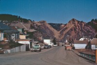 The open cut in the Homestake Mine (background), Lead, S. Dak., was mostly created by the collapse of underground mine workings. USGS scientists studied the fate, transport, and effects of large volumes of arsenopyrite-bearing tailings discharged into the environment for over 100 years - see caption below
