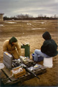 USGS scientists sampling at a multi-level well